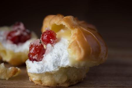 choux: Choux Cream Stuffed With Custard Cream with berries Stock Photo