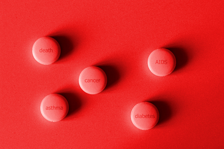 tablets with incurable illnesses in red light