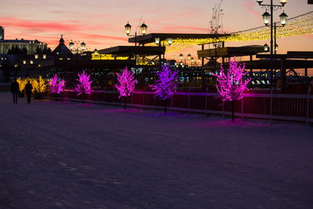 polis: Christmas decoration on a street, illuminated trees Stock Photo