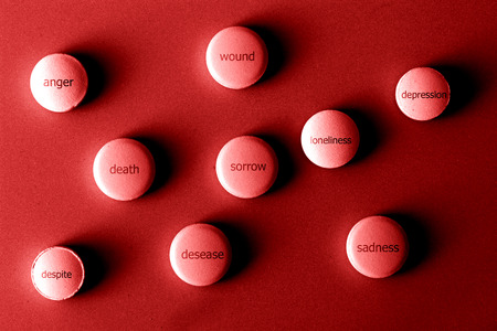 blackwhite: pills with negative emotions on metal background Stock Photo