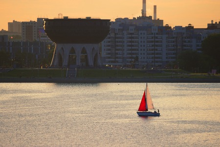 sailing boat with red sail