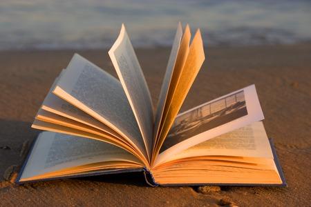 open book on the beach.sunset warm light Stock Photo