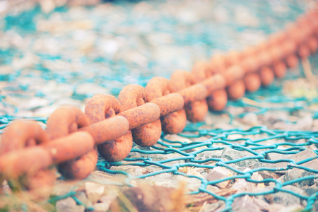 rusty chain: old rusty boat chain on blue background