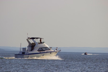 motorboat with waves on the sea, sunny summer day
