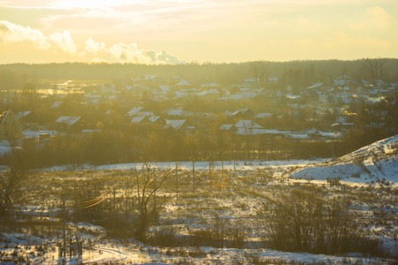 beautiful winter landscape. cottages in a sunlight