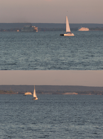 ship bow: distant sailing boats on the water. vertical