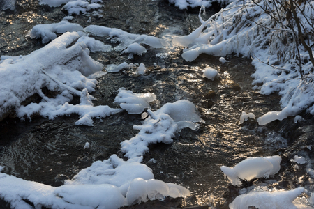Beautiful river in winter forest with fairy trees sunlight Stock Photo