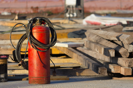 red fire extinguisher in a constraction background Stock Photo