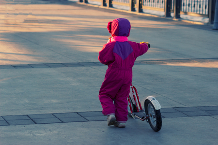 old school bike: Happy child riding a bike. Little girl on a pink bicycle.