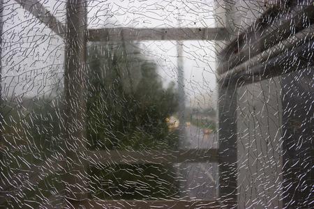 triplex: Shattered window. unfocused view thought the brocken window Stock Photo