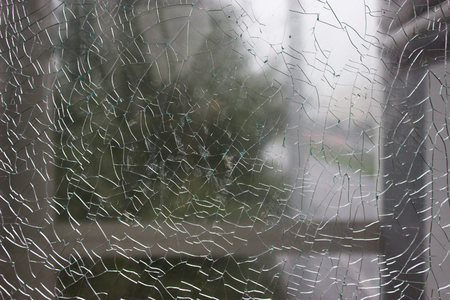 Shattered window. unfocused view thought the brocken window Stock Photo