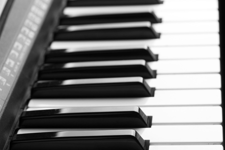 forte: Close-up of piano keyboard. Close frontal view