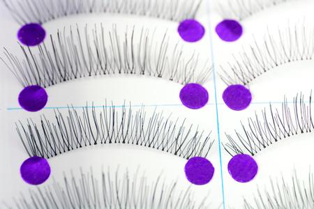 fmany pairs of alse eyelashes on white background Stock Photo