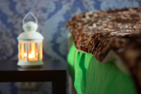 beautiful lantern near the bed. romantic concept