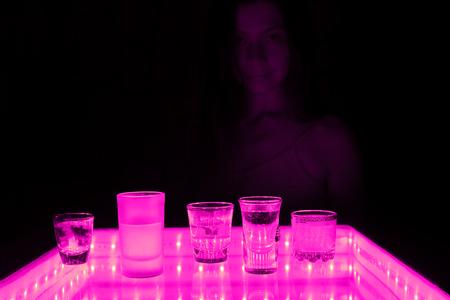 woman work as a barmen in a club 版權商用圖片