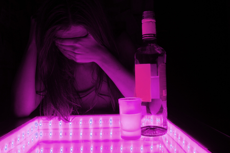 young woman cry. alcohol beside her. depression, problems concept