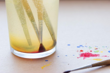 co: paintbrushes in glass with water. artistic concept Stock Photo