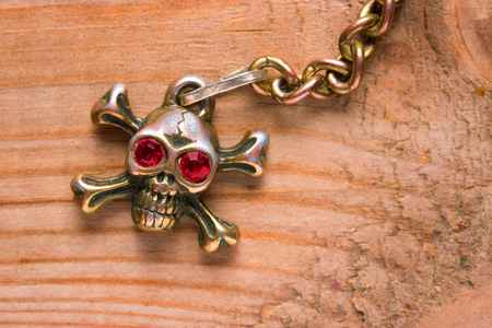 close up of metal skull with red eyes. pirate concept Stock Photo