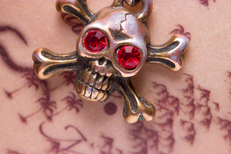 frightfulness: close up of metal skull with red eyes. pirate concept Stock Photo
