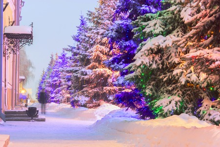 illuminated christmas tree covered with snow. outdoor. Russia Kazan