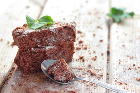 Brownie, closeup chocolate cake on a rustic wooden table, selective focus Stockfoto