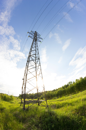 power line in a contryside. shooted with fisheye lens Stock Photo
