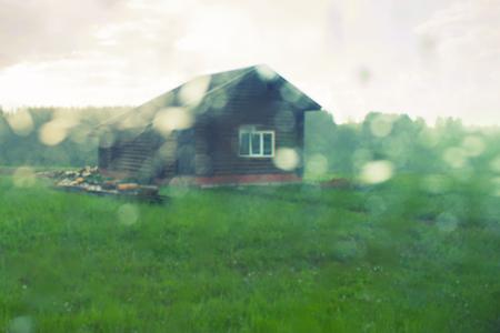 An old house on the prairie. rain. blur