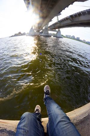 legs on the bridge edge. suicide concept 版權商用圖片