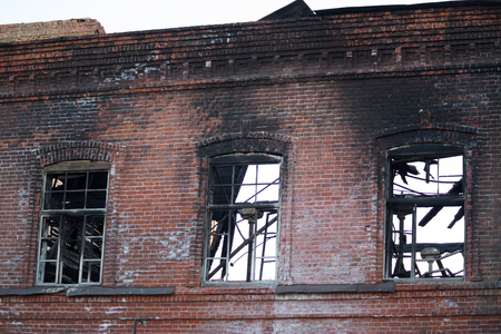 builing after a fire. burned windows and roof Stock Photo