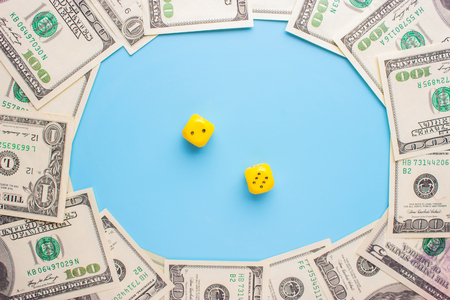 gambling and money concept. 100 dollar bills and dice Stock Photo