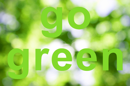 go green words on green background. ecology concept