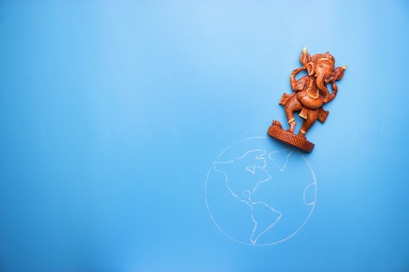 ganesha statuette on the earth. peace in the world concept Stock Photo