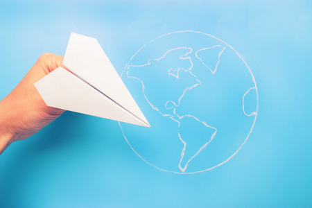 plane above world map. travel and tourism concept Stockfoto