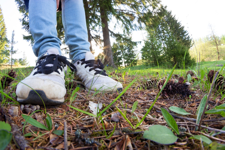 woman legs in sneakers on green grass. sport and healthy Stock Photo