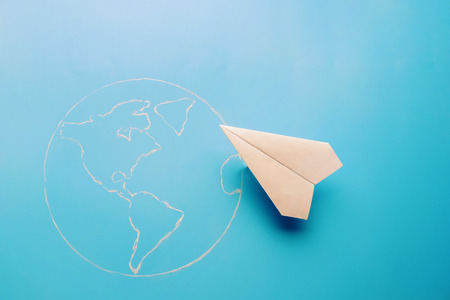 plane above world map. travel and tourism concept Stock Photo