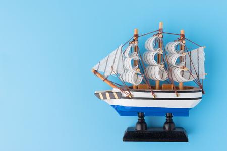 Toy ship on blue backround. copy space