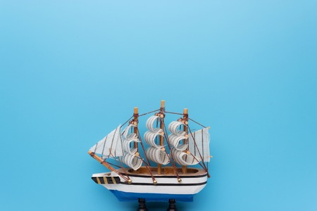 Toy ship on blue backround. copy space