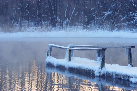 frozen wooden bridge in a lake. very slipery Standard-Bild