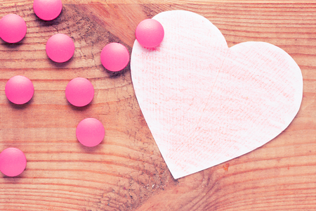 medicne for heart concept. copy space. pink tablets