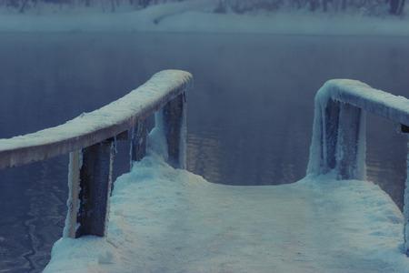 frozen wooden bridge in a lake. very slipery 스톡 콘텐츠