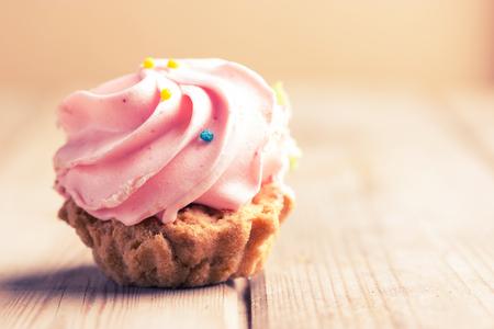 sweet pink cupcake. close up. toned image