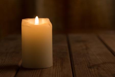 single big candle burning. valentine day. halloween