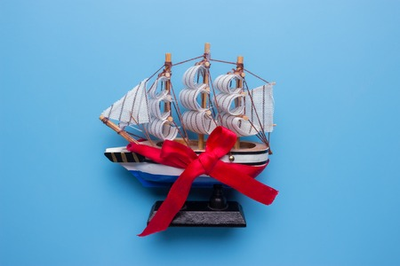 ship model with red bow. yacht as a present