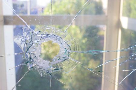 broken glass window reflecting blue sky. close up Stock Photo
