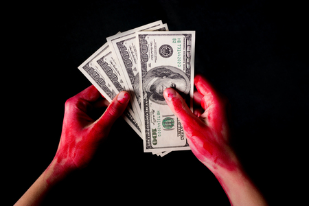 man in handcuffs arrested for bribe with hand in blood Stock Photo