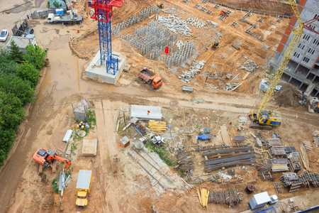 Blurred crane and building construction site as background. top view