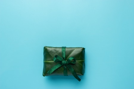 Eco friendly gift wrapped in green leaf on eco paper