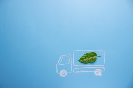 Electric car concept in green environment. lorry with green leaf