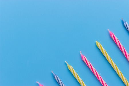 Birthday candles on blue background. close up Imagens