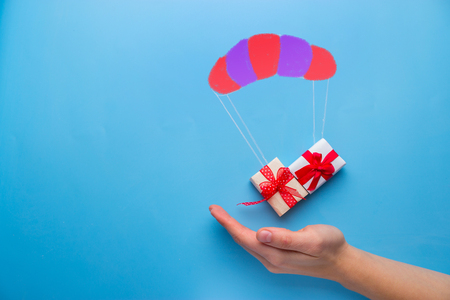 beautiful gift box falling down with parachute
